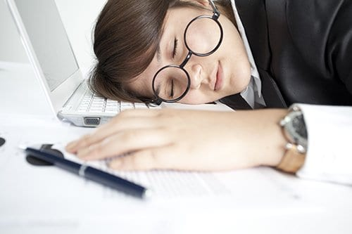 Woman experiencing screen fatigue.